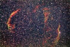 The Veil Nebula Supernova Remnant  The Veil Nebula is the remnant of a supernova explosion that occurred about 5 - 10,000 years ago. It is located 1,400 light years away in the constellation of Cygnus.