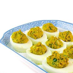 Yummy Deviled Eggs with Curry and Cilantro. And my mom thought adding relish was spicing things up!