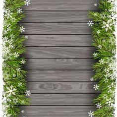 Galhos de árvores de Natal em um fundo de madeira