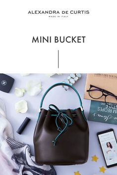 Are you looking for a designer leather handbag? Click through to check out the Mini Bucket, handmade in Italy with smooth and lightweight Italian leather! Alexandra de Curtis #leatherhandbag #designerhandbag #italianhandbag