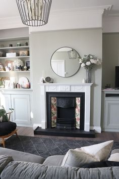 victorian fireplace, mizzle, open shelving, round mirror The decoration is th. Victorian Living Room, Victorian Fireplace, Cottage Living Rooms, Living Room Green, Living Room Carpet, New Living Room, Home And Living, Living Room Decor, Farrow And Ball Living Room
