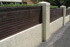 A combination fence, wood and masonry.