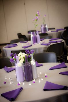 Wine bottle center pieces.  I spray painted them 3 different shades of purple and used silver balance out.