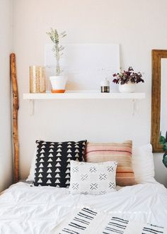 boho bedroom vibes | graphic print pillows & pale pink walls