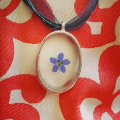 Surprise her with a gift! Real forget me not encased in resin pendant...eternal love