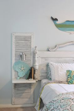 Shabby chic beAch bedroom. Awesome shutter nightstands built onto a headboard made from an old door. Sconces are mounted, and shelves added, to look like one giant custom made, and painted piece. Theraggedwren.blogspot.com