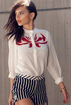 Emily Ratajkowski wearing white long sleeved shirt and striped shorts