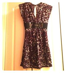 Rue 21 top NWOT Purple, gray, white, and black cheetah print top from Rue 21. The top has a long key hole opening in the back, a belt, and ties in the back . It has never been worn so it's in excellent condition. Rue 21 Tops