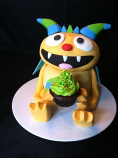 Henry Hugglemonster - *  My son's new favorite show is Henry Hugglemonster on Disney Jr. So we made this cake for him today for his 3rd birthday! A few problems but otherwise turned out great and was easy to do!