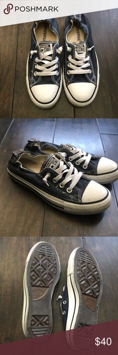 Converse navy Size 6  Worn maybe 4 times total.  I have grey ones I wear mostly.  These are the slip on converse. You don't tie them. My favvvvv!! Because I'm lazy!!!! Converse Shoes Sneakers