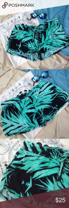 """Hurley Tropical Palm Shorts Super soft Hurley shorts with gorgeous green and black palm frond print. Elastic waistband with drawstring tie. Size small. 13.5"""" laying flat across top of waistband. 1"""" inseam. 100% rayon. Cute beachy surfer vibe. Hurley Shorts"""