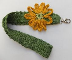 Groene keycord met grote gele bloem -  L27 x B3 cm