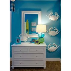great beach room... Love the blue green and white, but the crabs remind me of huge spiders