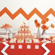 """Mad For Zig Zag  Taking center stage: a tower of carrot cupcakes, trimmed in hand-pleated striped card stock.  """"It's one of my favorite ways to add a vertical element."""" Curvier elements like the retro rickrack and gerbera daisies add a soft touch."""