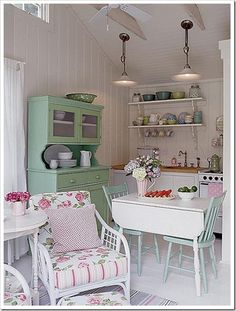 cottage kitchen in pink and green. I'm not a big fan of pink, but this is still pretty cute. And I think that might be the perfect shade of green for the yardsale hutch that I have....