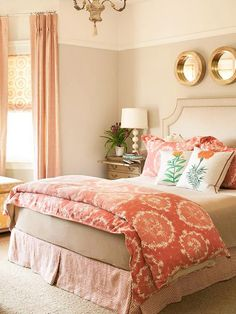 Coral bedroom at its best!  Love this!  tan walls with gold mirrors and calm bedding makes the carpet look great!