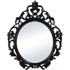 Make a dramatic statement in your home with the Better Homes & Gardens Baroque Oval Wall Mirror . This ornate mirror boasts an intricate floral detail.