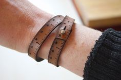 For an efficient measuring tool on the go, the Wrist Ruler offers inch and centimeter measurements laser cut into a snappy leather wrap bracelet that circles yo