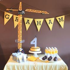 Construction cake (kcommunicated.com): Wrap a number or letter in duct tape for an easy cake topper (and connect it to a toy crane for extra fun); great for a construction, dump truck, crane birthday party and more