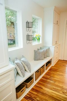 In the entryway of the home, this window seat provides a functional space for storage and seating near the kitchen, as seen on HGTV's Fixer Upper. Estilo Joanna Gaines, Coastal Living Rooms, Modern Coastal, Coastal Decor, Coastal Furniture, Coastal Style, Finding A House, Home Decor Bedroom, Master Bedroom