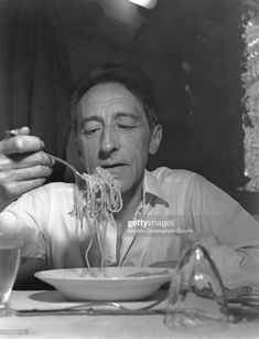 News Photo : French writer Jean Cocteau sitting at a set...