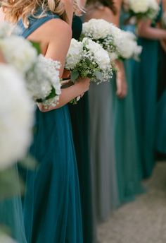Shades of blue, green, grey = utterly chic bridesmaid lineup // Corey Fox Photography