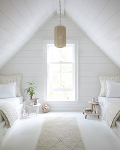 This room is very bland because its very white making it look very clean and sterile. Its also very symmetrical giving off that harmonic value Small Attic Bedrooms, Beach Cottage Bedrooms, Attic Bedroom Ideas Angled Ceilings, Rooms With Slanted Ceilings, Attic Bedroom Kids, Slanted Ceiling Bedroom, Bonus Room Bedroom, Attic Living Rooms, Dormer Bedroom