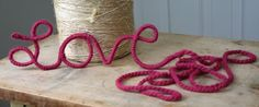 Yarn Love using a wire reinforced clothesline (available at home improvement & hardware stores), yarn & wire clippers. Clip off a length of clothesline and shape into the word, LOVE. Tie yarn onto beginning of word and wrap around wire.