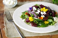 Beet Salad with Edible Flowers on http://www.draxe.com