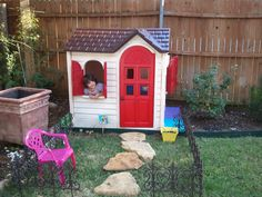 Little Tikes Playhouse found super cheap on craiglist and a few cans of Rustoleum Plastic spray paint and Voila! Home Sweet Toddler Fun Home!