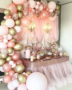 pink and gold baby shower, large balloon arch, pink tulle, gold sequins, flower bouquets, dessert table