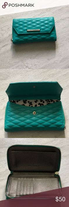 Rebecca Minkoff Teal Wallet Rebecca Minkoff Zip Wallet. Can fit an iPhone 6, 7, and 8 inside. Still lots of life! Gorgeous teal color. Rebecca Minkoff Bags Wallets
