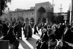 people walking in a street near the Husayn #Mosque #Karbala, December 1956 #Iraq