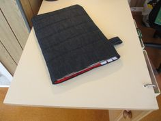 Nice instructable for making a laptop sleeve out of denim. I'd use denim and/or felted wool, and see if I could make a flap to keep the laptop in.