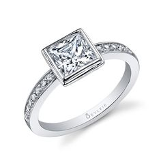 Style# SY911 Classic Bezel Princess Diamond Engagement Ring - This unique white gold engagement ring features a 1 carat princess cut center in a bezel setting with a total of 0.16 carats down the diamond shank. https://www.sylviecollection.com/classic-bezel-princess-diamond-engagement-ring-sy911