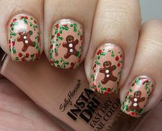 Taupe nails with a tiny gingerbread man surrounded by holly on each one. Person is holding a bottle of the base coat, Sally Hansen Insta-Dri in Quick Sand. Pick just one please!