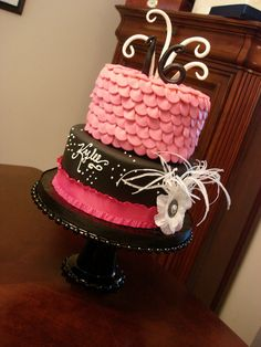 Pink & Black Birthday cake with feathered broche