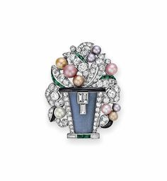 AN ART DECO DIAMOND AND MULTI-GEM BROOCH, BY MAUBOUSSIN Designed as a floral bouquet, extending circular and single-cut diamond leaves with multi-colored pearl buds and calibré-cut emerald and onyx detail, to the moonstone vase, mounted in platinum, circa 1925