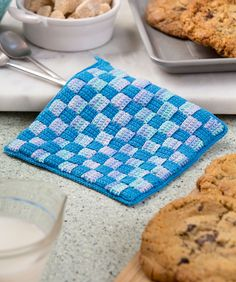 Checkered Hot Pad | Red Heart Crochet strips and then weave them together… this gives you a hot pad that is double thick and charmingly checkered! It's perfect as a hostess gift, shower gift or to enjoy using in your own kitchen.