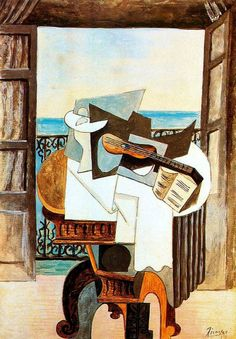 Picasso Table in front of the window 1919