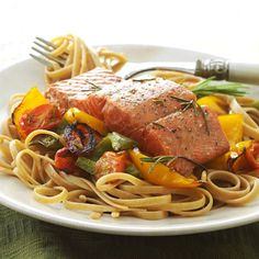 Salmon with Whole Wheat Pasta This dish is perfect to satisfy any big appetite. Whole wheat pasta is topped with roast peppers and salmon, which is all prepared with our tangy white-wine-based sauce. Diabetic Salmon Recipe, Salmon Recipes, Fish Recipes, Seafood Recipes, Pasta Recipes, Diabetic Recipes, Diabetic Foods, Vegetable Recipes, Gourmet