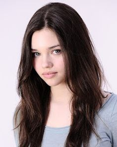 "Emilia's younger sister, Lucja ""Lucy"" Stanek (looks like actress India Joy Eisley)"