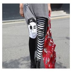 Pirate Skull Striped Leggings ❤ liked on Polyvore featuring pants, leggings, legging pants, white and black striped leggings, pirate pants, stripe leggings and black white leggings