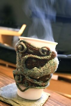 Knitted coffee cozy...made me think of some people I love.
