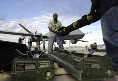 Hellfire missiles being loaded onto a US military Reaper drone in Afghanistan.