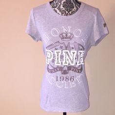 Victoria Secret Pink T-shirt Victoria's Secret Pink T-shirt. It has a little mark and distress on the left sleeve. Victoria's Secret Tops Tees - Short Sleeve
