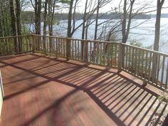 Here is a freshly refinished Mahogany deck using a semi-transparent stain. Like the dark flooring with lighter rail- would go even lighter though.