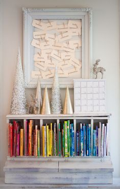 Oh, goodness! I love it all... the cleaness of the white above all the books in rainbow order!