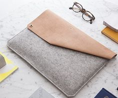 Introducing the Leather & Felt MacBook Air Sleeve by Alexej Nagel. Handmade in Hamburg, this case is made of super soft felt and strong, vegetable tanned leather.