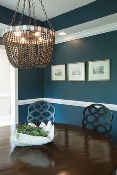 Traditional Dining Room by Elizabeth Reich   Paint:  Newburg Green by Benjamin Moore